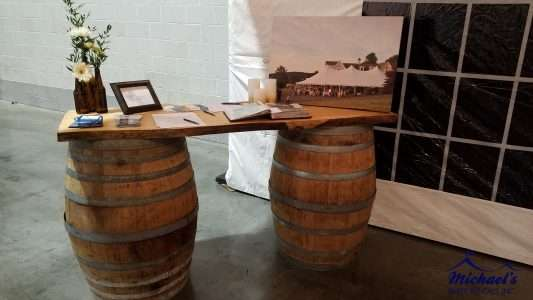 Plank Bar Rentals with wine barrels