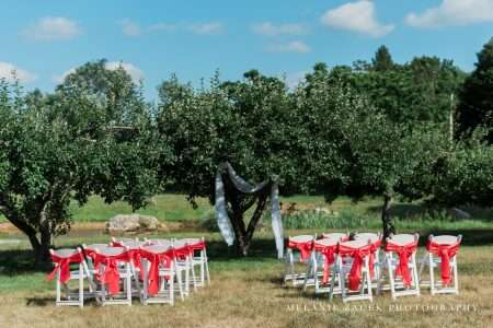 White padded garden chairs setup for a ceremony at Misty Meadows in Brookfield