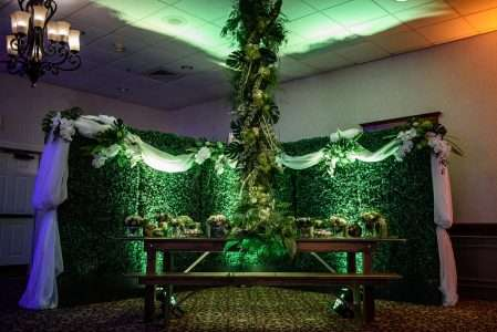Once Upon Time Gala with Colin Cowie- Farm table with bench and hedge wall rental Holyoke MA